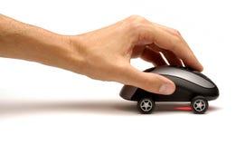 Mão que empurra o rato do computador Fotos de Stock