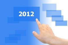 Mão que empurra a tecla 2012 Fotografia de Stock