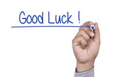 Mão que escreve a boa sorte Imagem de Stock