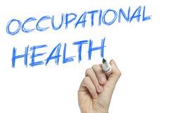 Mão que escreve a saúde ocupacional Fotografia de Stock Royalty Free