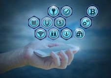 mão que guarda ícones do telefone e do negócio Foto de Stock Royalty Free