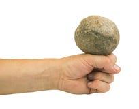 Mão que guarda a bola de pedra Fotografia de Stock