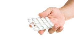 Mão que guarda a bolha com pastilhas elásticas fotografia de stock royalty free