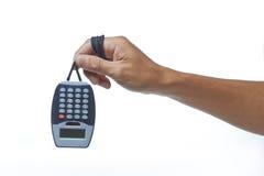 Mão que guarda a calculadora Fotos de Stock Royalty Free
