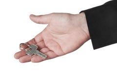 Mão que guarda a chave da segurança Foto de Stock