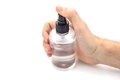 Mão que guarda a lata de pulverizador transparente Foto de Stock Royalty Free
