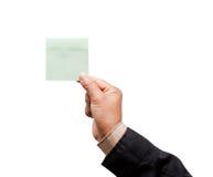 Mão que guarda a nota de post-it fotografia de stock