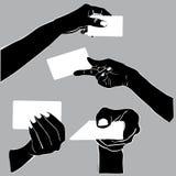 Mão que guarda o cartão no projeto da sombra Foto de Stock