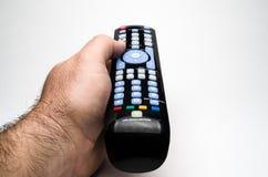 Mão que guarda o controlo a distância Imagens de Stock Royalty Free