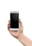 Mão que guarda o isolado branco do telefone Imagens de Stock