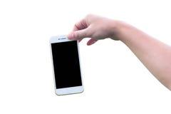 Mão que guarda o isolado branco do telefone Imagens de Stock Royalty Free