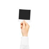Mão que guarda o modelo vazio do quadro da foto Fotografia velha vazia Fotos de Stock