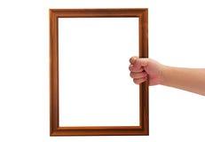 Mão que guarda o quadro Fotos de Stock
