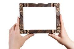 Mão que guarda o quadro da foto Imagens de Stock