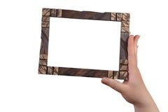 Mão que guarda o quadro da foto Foto de Stock
