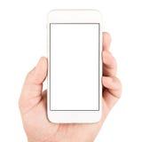 Mão que guarda o smartphone branco Fotos de Stock