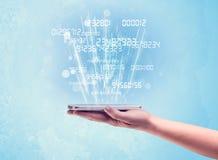 Mão que guarda o telefone com números digitais Imagem de Stock Royalty Free