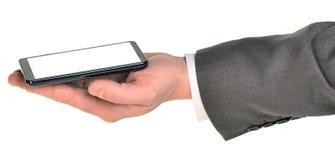 Mão que guarda o telefone esperto com tela vazia imagens de stock