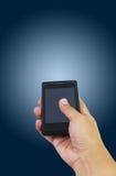 Mão que guarda o telefone esperto no branco Imagem de Stock Royalty Free