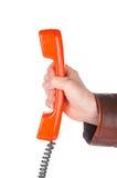 Mão que guarda o tubo retro do telefone imagem de stock royalty free