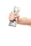 Mão que guarda a pilha de notas do dólar americano imagem de stock royalty free