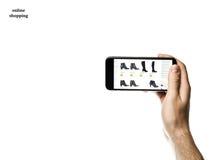 Mão que guarda Smartphone no fundo branco Foto de Stock