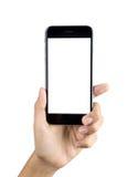 Mão que guarda a tela vazia do telefone esperto Foto de Stock