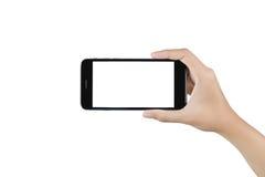 Mão que guarda a tela vazia do telefone esperto Imagem de Stock Royalty Free