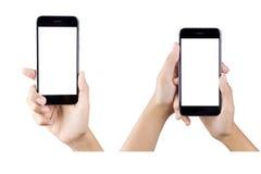 Mão que guarda a tela vazia do telefone esperto Imagens de Stock