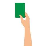 Mão que guarda um cartão verde no fundo branco Foto de Stock Royalty Free