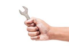 Mão que guarda uma chave inglesa Fotografia de Stock