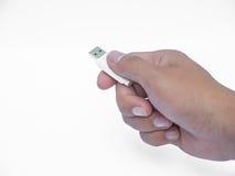 Mão que guarda USB Fotos de Stock Royalty Free