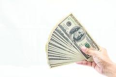 Mão que guardara cem dólares Foto de Stock Royalty Free