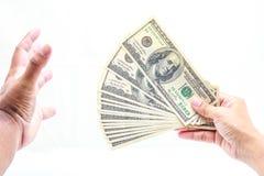 Mão que guardara cem dólares Imagem de Stock Royalty Free