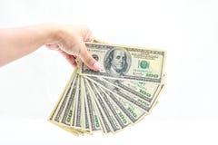 Mão que guardara cem dólares Fotografia de Stock