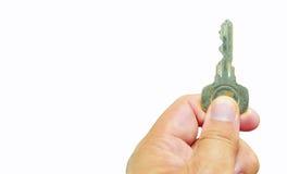 Mão que guardara a chave Imagens de Stock Royalty Free