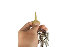 Mão que guardara a chave imagem de stock royalty free