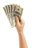 Mão que guardara dólares Fotografia de Stock Royalty Free
