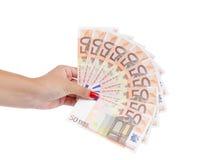 Mão que guardara notas de cinqüênta-Euro Fotografia de Stock