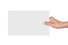 Mão que guardara o cartão Fotos de Stock Royalty Free