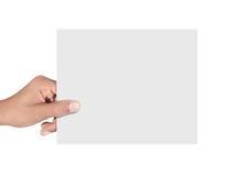 Mão que guardara o cartão Fotografia de Stock