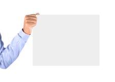 Mão que guardara o cartão Foto de Stock