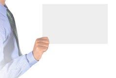 Mão que guardara o cartão Imagem de Stock Royalty Free