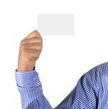 Mão que guardara o cartão Foto de Stock Royalty Free