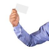 Mão que guardara o cartão Imagem de Stock