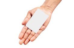 Mão que guardara o cartão Imagens de Stock