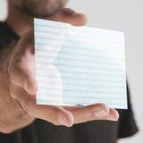 Mão que guardara o graphene transparente com números. Conceito. imagens de stock