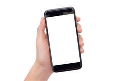 Mão que guardara um smartphone Fotos de Stock Royalty Free