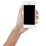 Mão que indica o monofone móvel o mais atrasado Imagens de Stock