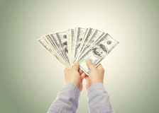 Mão que indica uma propagação do dinheiro Imagem de Stock